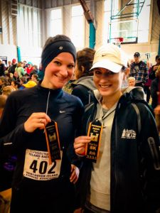Deb and me with our 10th and 8th place age group ribbons!